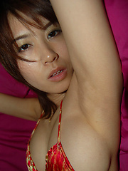 Delectable asian beauty seduces in her skimpy little bikini