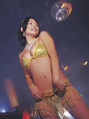 Cute asian babe in a purple bikini shows her big massive boobs