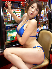 Sizzling asian hottie plays the slots in her purple bikini