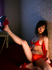 Captivating gravure idol chick seduces in her red lace lingerie