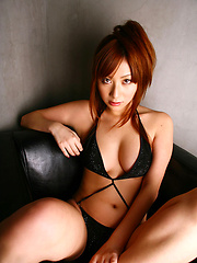 Delicious long haired asian babe in a black slinky bikini