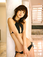 Adorable asian cutie with a perfect body posing in black lingerie