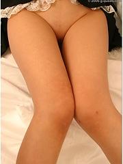 Sexy brown asian model Mariko Kitahara in maid uniform and nylon body