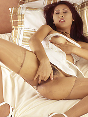 Tied up Thai girl Muk fingers her wet juicy slit