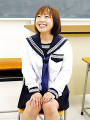 Schoolgirl Norika touching her smooth hole