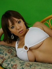 Hitomi Tanaka posing in white bikini her gigantic perfect tits!