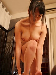 Japanese woman takes off clothes for sexy pussy massage