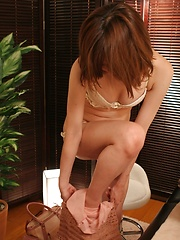 Brown-haired japanese in massage cabinet