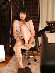 Japanese MILF toyed on the massage table