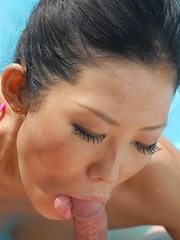 Japanese girl Yui Komine sucking a cock