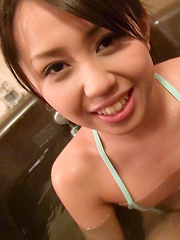 Satsuki's wild challenge was to wear this tiny blue bikini in the bathtub and keep her intimate parts from popping out. Easy for such a cute Japanese girl!