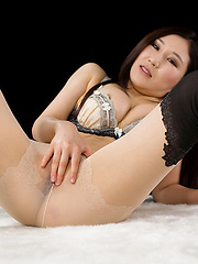 Kazuki Yuu posing in different stockings
