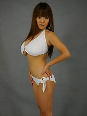 Hitomi Tanaka huge monster boobs posing in white bikini