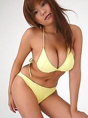 Av idol Yoko Matsugane posing in yellow bikini