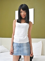 Japanese girl Yuu shows her shaved pussy