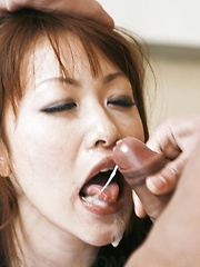 Rika Kurachi Asian with mask on eyes gets two cocks in mouth