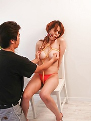 Moe Aizawa Asian with boobs in yellow ropes is fingered in slit