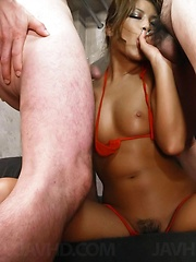 Golden-skinned and glam Rumika eats cum while toyed