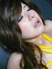 Shy Suzanna in yellow rope shibari gets dizzy during toying