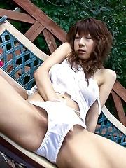 Asuka Ishihara Asian fucks her beaver with vibrator outdoor