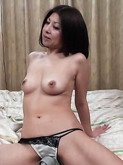 Junko Asian has vagina treated with vibrators and middle finger