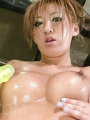 Hina Maeda Asian plays with hot oiled tits and with cloth on twat