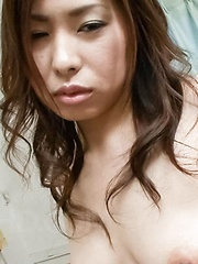 Chie Inamori Asian is undressed and has dark hairy pussy fingered