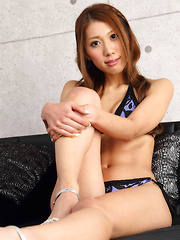Reika Miki Asian with sexy legs on heels poses in cat positions