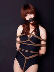 Lala Asian babe in bath suit has hands tied of her boobs in ropes