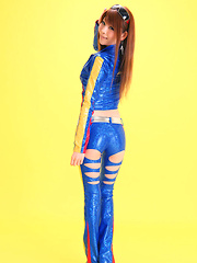 Minami Haduki Asian plays withlatex suit showing some curves