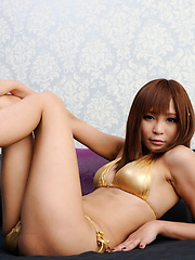 Sayuri Ono Asian with long legs exposes sexy body in gold outfit