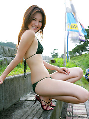 Haruna Yabuki Asian shows her leering curves in different outfits