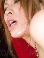 Ai Sakura Asian with oiled curves rubs her clit and rides dildo