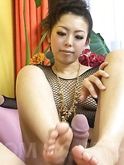 Yuki Asami Asian in fishnet strokes and rubs joystick with feet