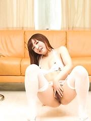 Mami Asakura Asian licks dildos and fucks her pussy with them