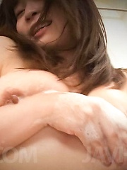 Nozomi Hatsuki Asian puts soap foam on her big jugs and on peach