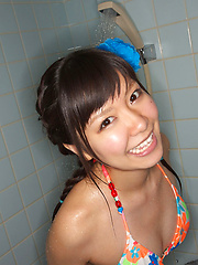 Sweet Ayana Tanigaki smiles and poses at the kitchen with banana