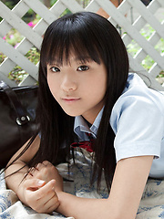 Miho Morita Asian takes school uniform off and shows body outdoor