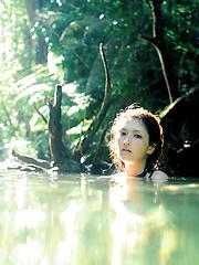 Neo Asian babe in white dress loves feeling her body in water