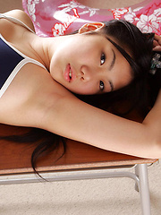 Miho Takai Asian in nylon outfit plays with ball and on desks