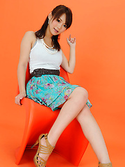 Yumi Asian honey on heels and with big eyes is elegant and sexy