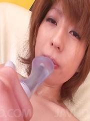 Rei Sasaki Asian puts vibrators on and inside her pink fuck hole
