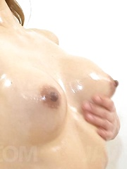 Ryuu Narushima caresses her body with oil and rides fake penis