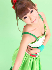 Zuo Qi Asian doll in cute outfit smiles like a true princess