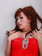 Sandy Asian in red dress is so leering touching her sexy lips