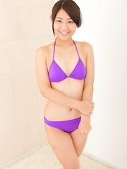Akari Tamura posing in the pink lingerie
