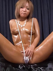 Riku Hinano Asian with oiled curves fucks shaved cunt with dildo
