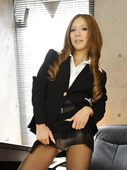 Ramu Nagatsuki poses in black nylon stockings