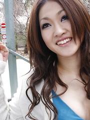 Aorusing brunette Yu Yamashita poses outdoor
