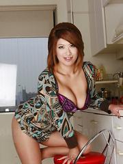 Sexy busty Miwa Nishiki poses in her kitchen